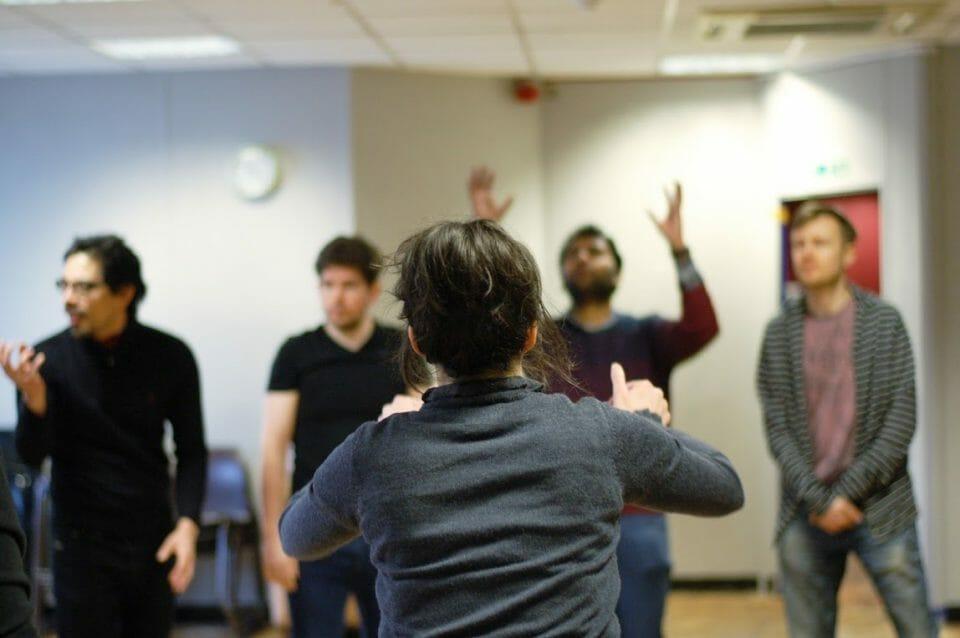 Behind improviser during workshop
